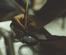 Unsplash photo-Inspect magnifying glass Financial Investigations Square