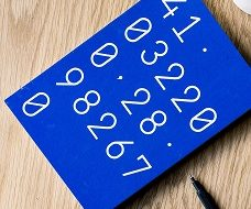 Unsplash photo-computer and blue book with numbers Capital Allowances square