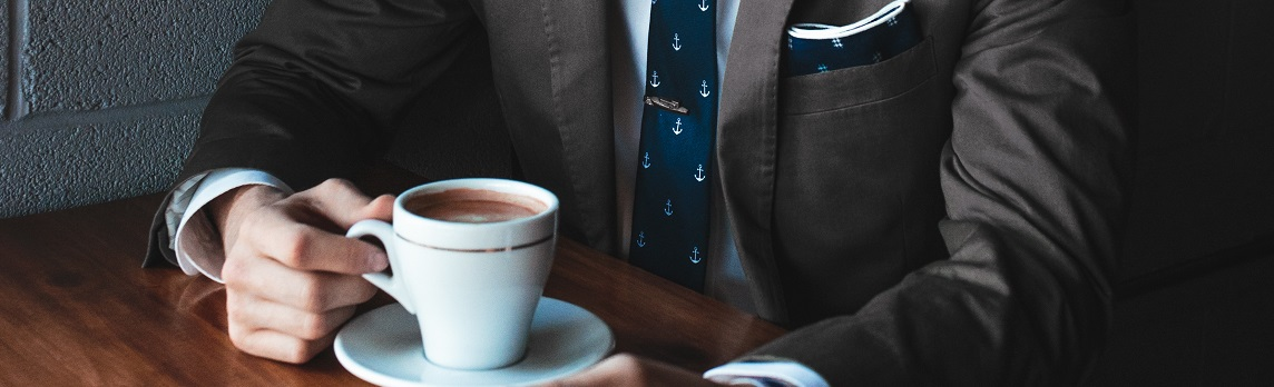 Unsplash photo-man in suit with coffee cropped