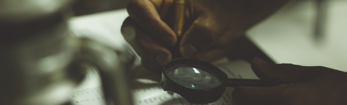 Unsplash photo-Inspect magnifying glass cropped