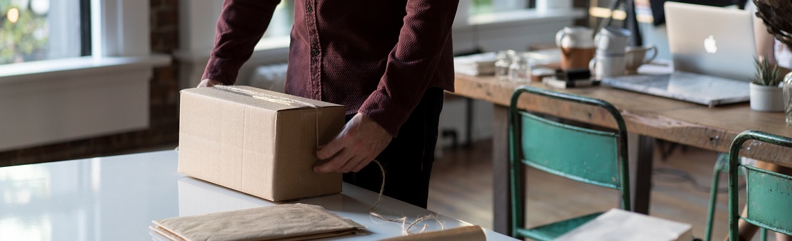 Unsplash photo-Man wrapping a parcel cropped