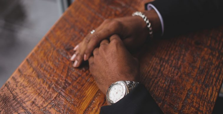Unsplash photo-hands with watch on wood background cropped landing page