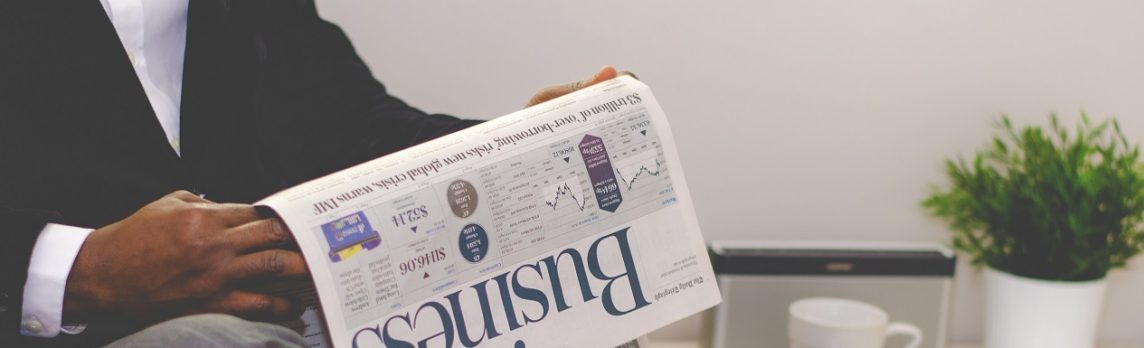 Unsplash photo-man reading Business newspaper cropped landing page