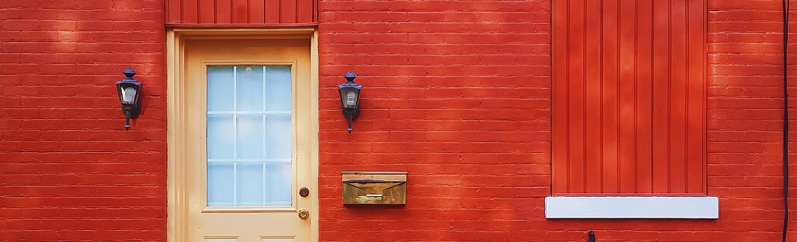 Unsplash photo-Beige door on red house cropped